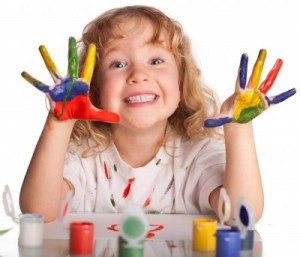 Mission - Mea'Alofa Autism Support Center - Young girl with paint on hands