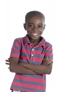 ABA Therapy - African American boy smiling with arms crossed